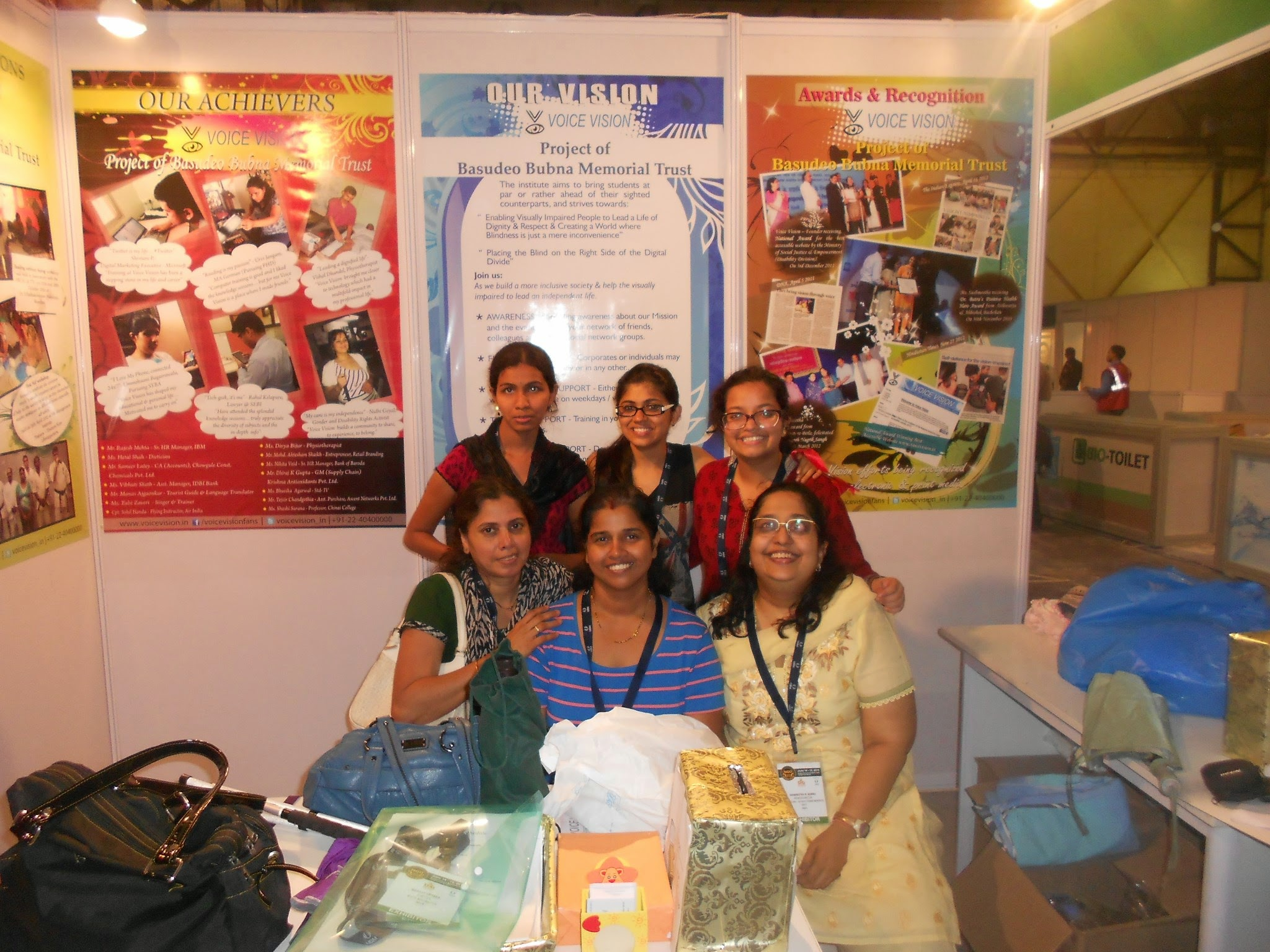 picture of voice vision founder with volunteers at the stall