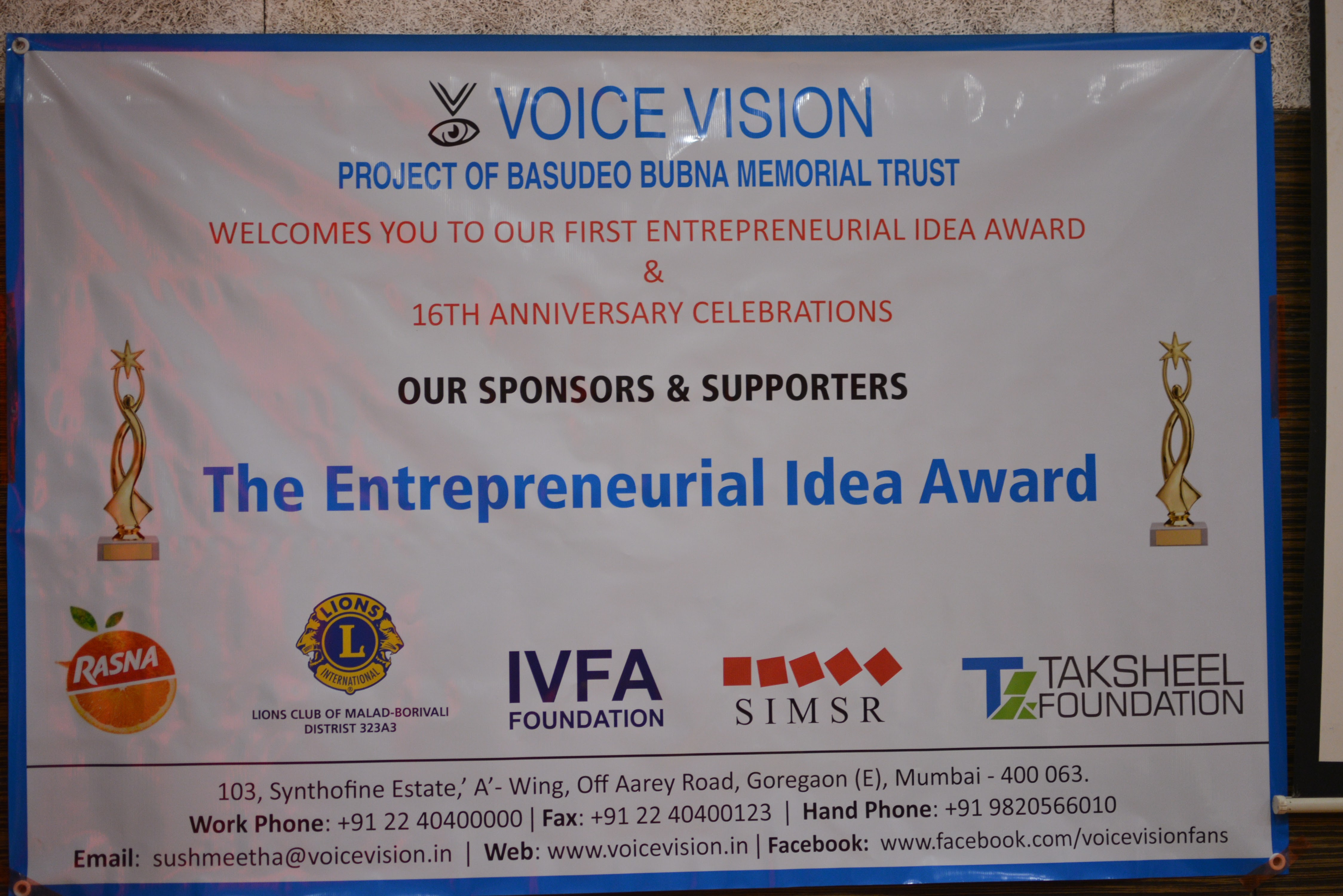 a picture of event banner with logos of sponsors such as Fanta, Taksheel foundation etc